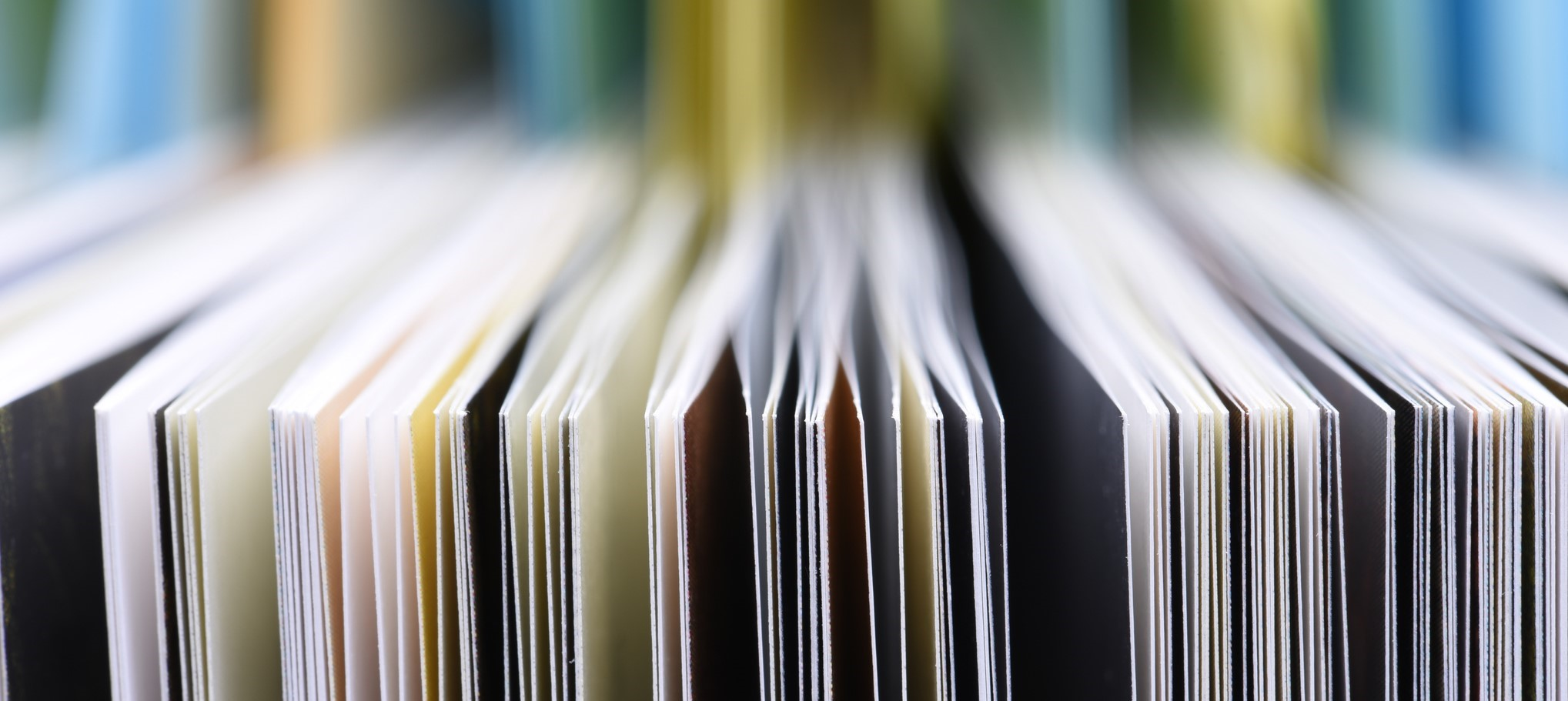 Publication booklets stacked together in an upright position